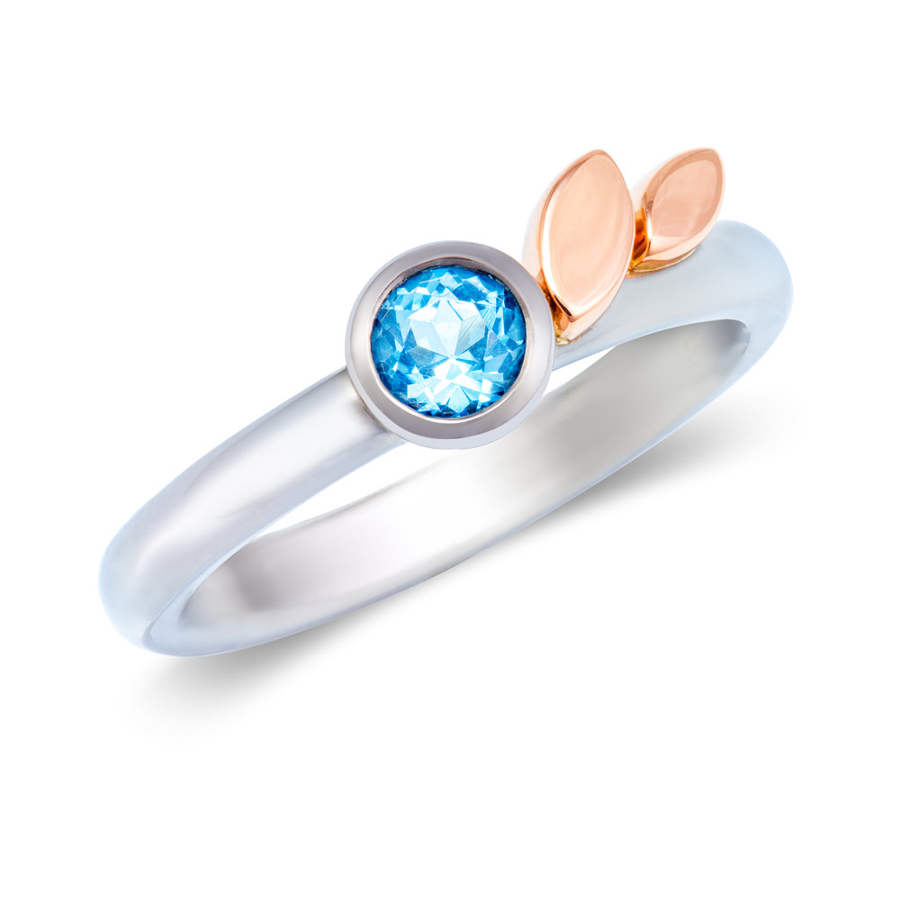 18ct white gold and 18ct rose gold engagement ring set with one swiss blue topaz - £1,416