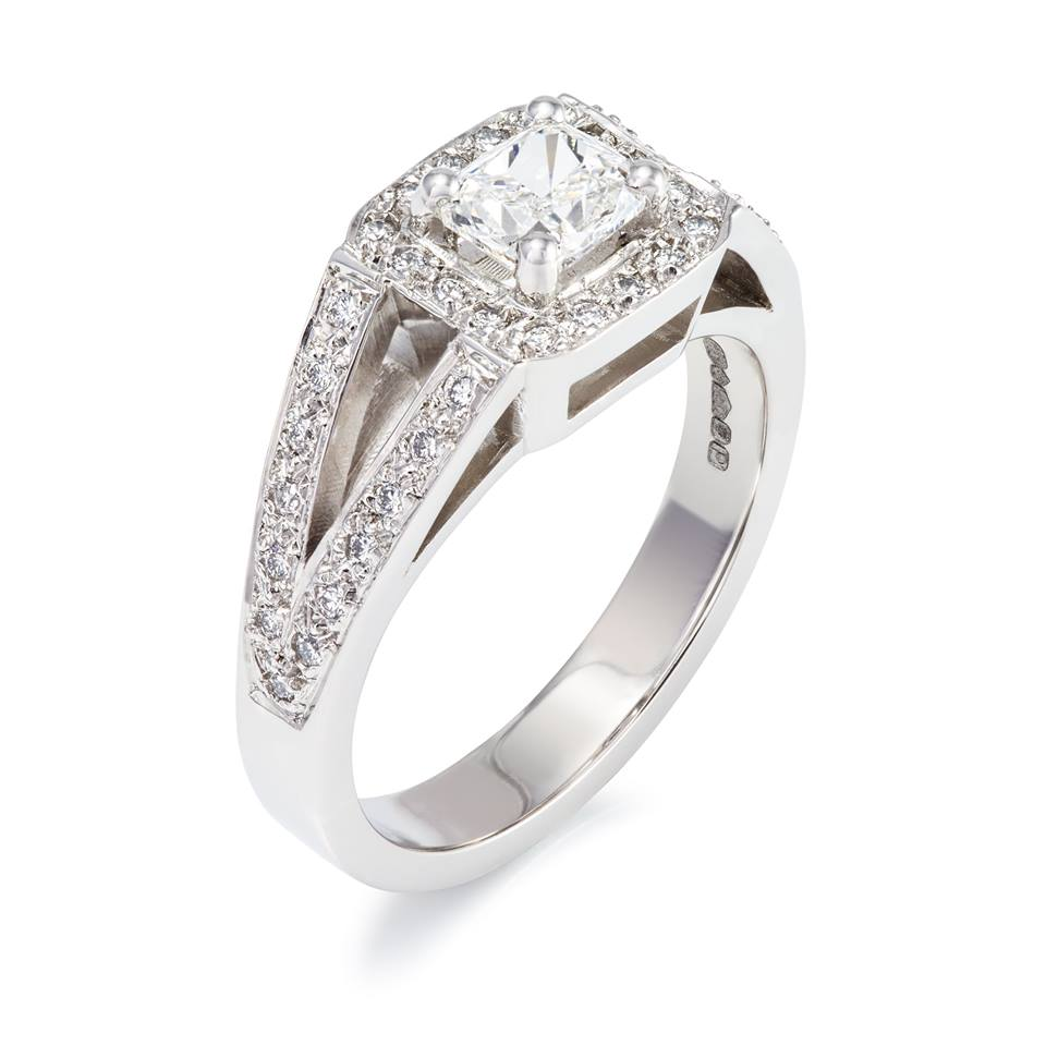 Platinum engagement ring set with one cushion cut diamond and forty-two round brilliant cut diamonds - £6,437