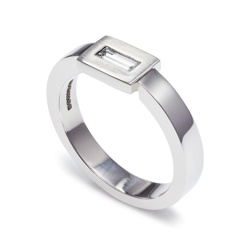 Palladium engagement ring set with one baguette diamond - £1,275