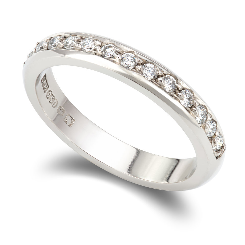Palladium ring set with fourteen round brilliant cut diamonds - £1,345