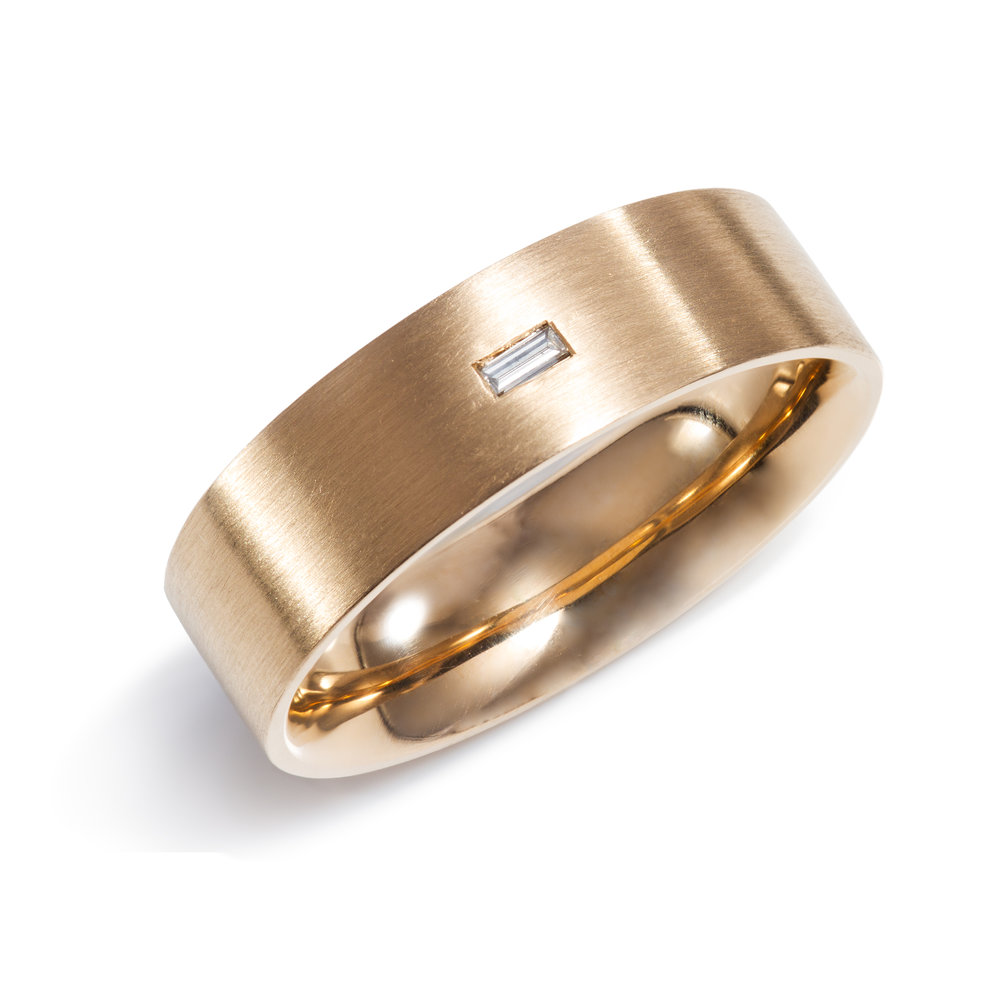 9ct rose gold wedding ring set with one baguette diamond - £960