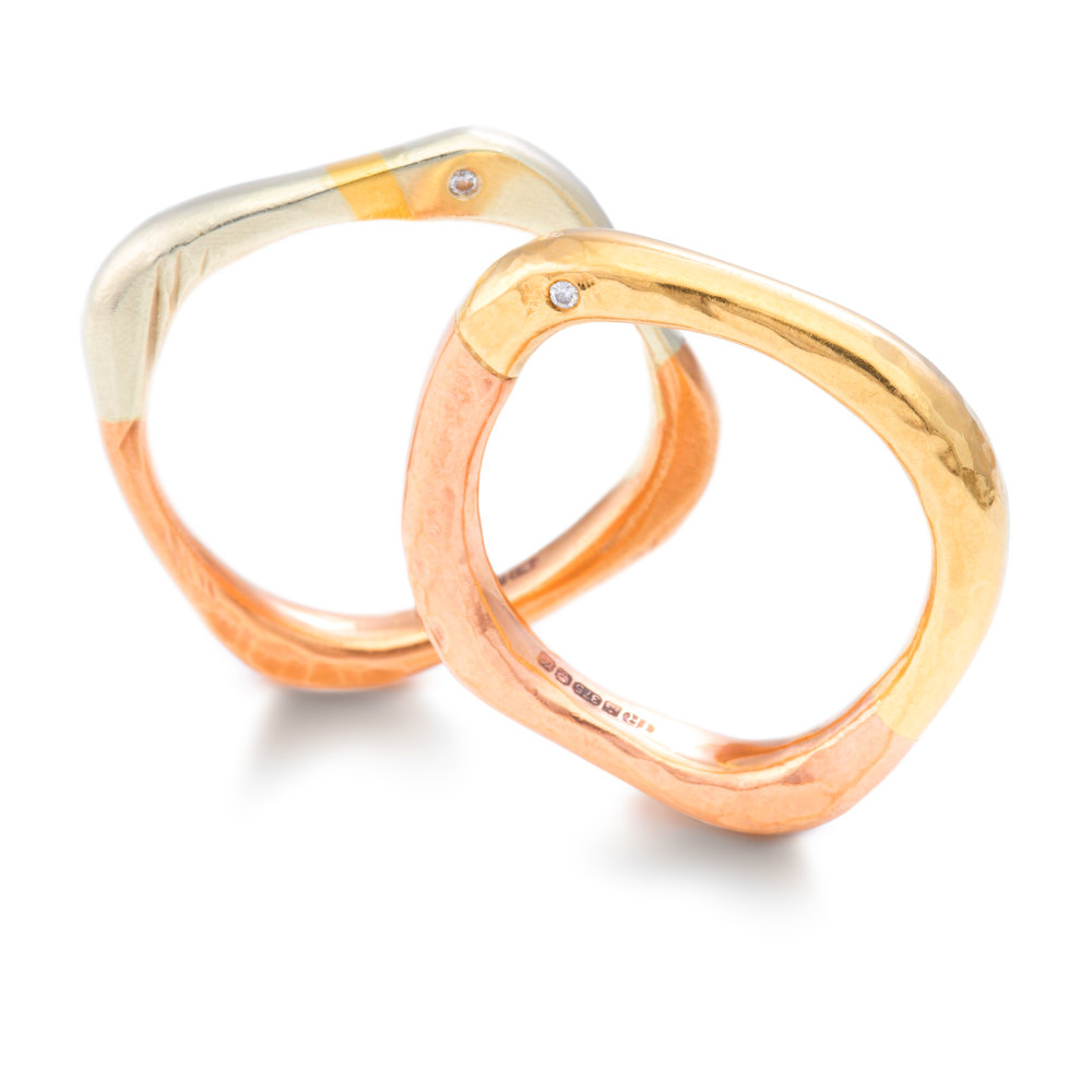 9ct white, rose and yellow gold wedding ring set with two diamonds - £918 9ct yellow and rose gold wedding ring set with two diamonds - £875