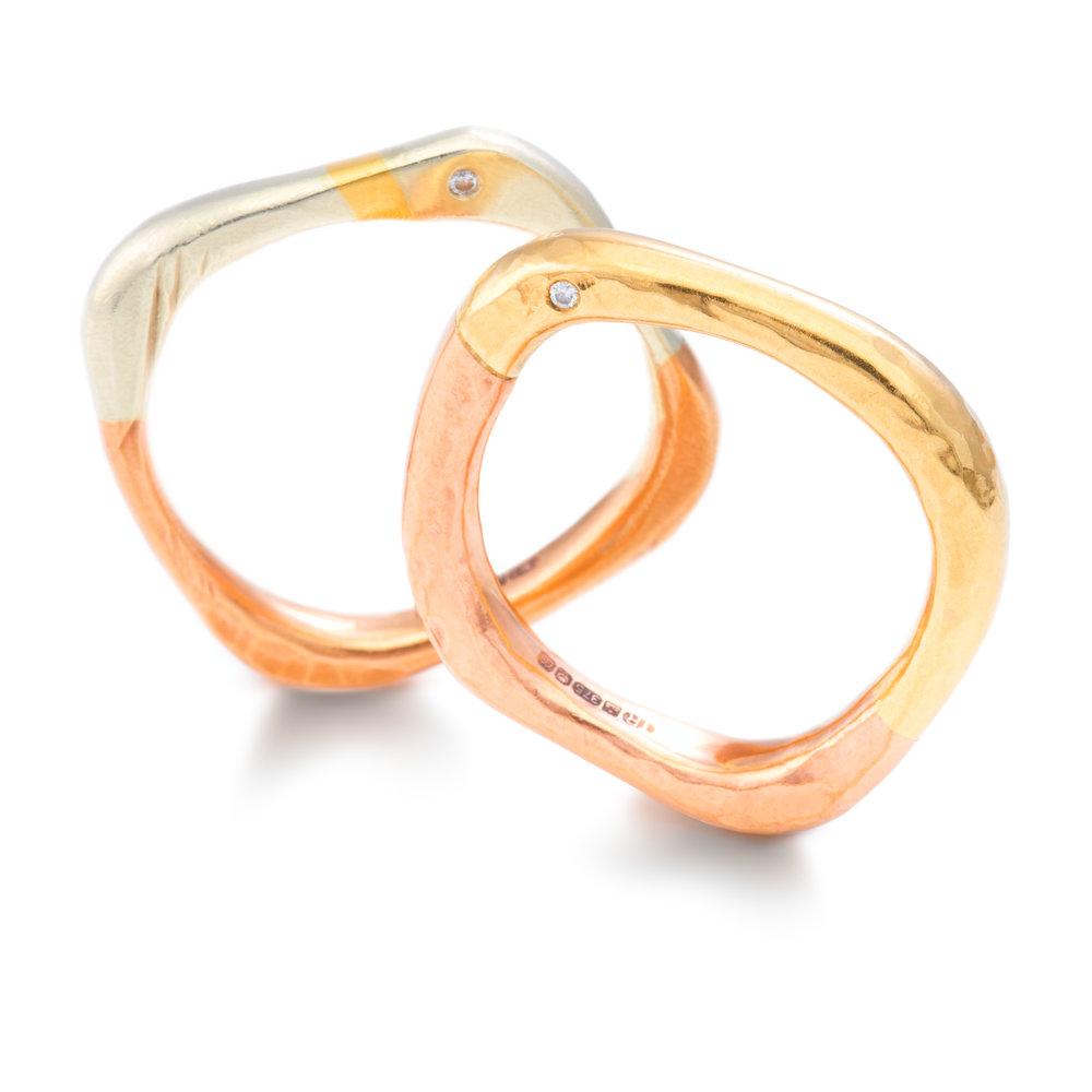 9ct white, rose and yellow gold wedding ring set with two diamonds - £918 9ct yellow and rose gold wedding ring set with two diamonds - £875