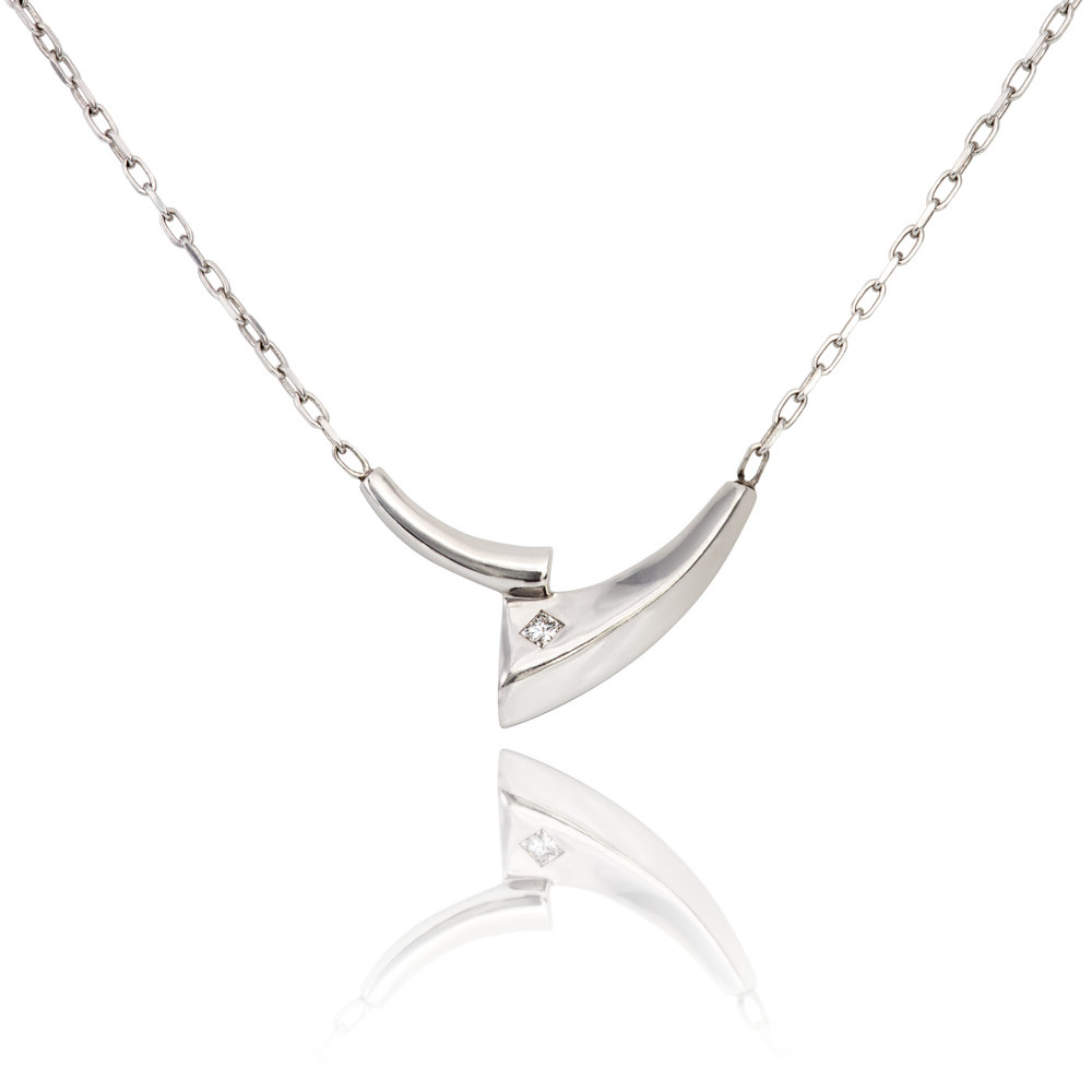 9ct white gold pendant set with one princess cut diamond, complete on a 9ct white gold chain - £1,085