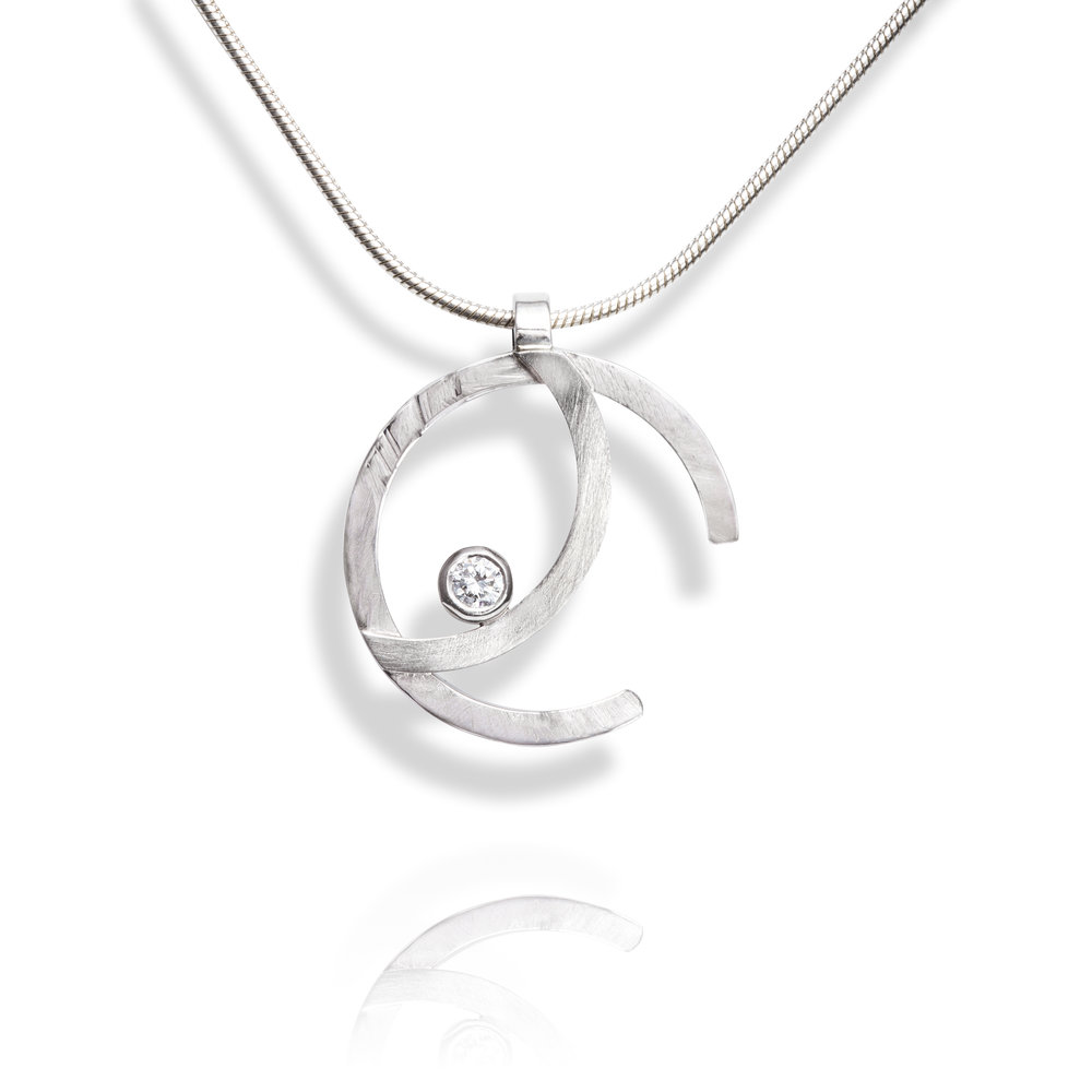 Palladium pendant set with one round brilliant cut diamond, complete on a 9ct white gold chain - £1,185