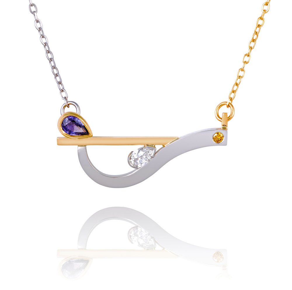 Palladium and 18ct yellow gold pendant set with one pear shaped purple sapphire, one pear shaped diamond and one natural yellow diamond. Complete on an 18ct white and yellow gold chain - £2,990