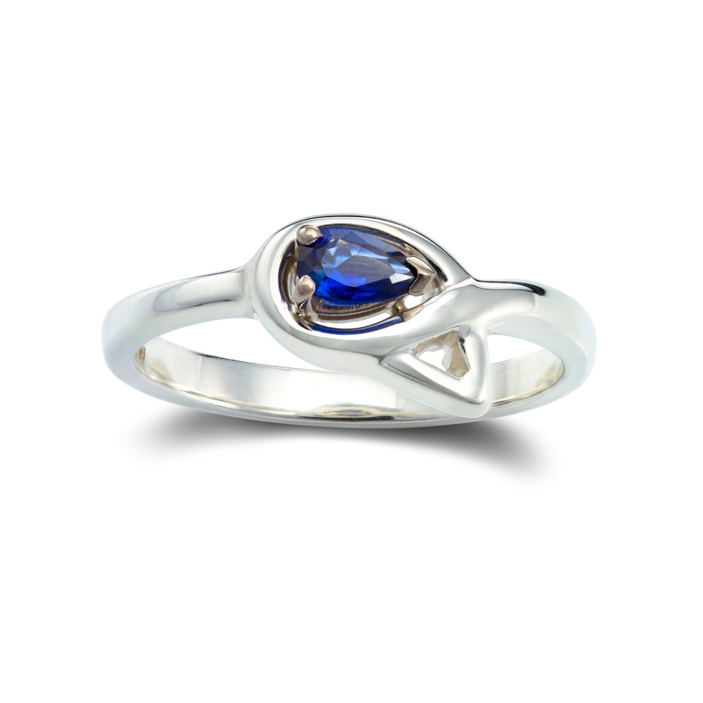 Silver ring set with one lab created sapphire in an 18ct white gold claw setting - £255