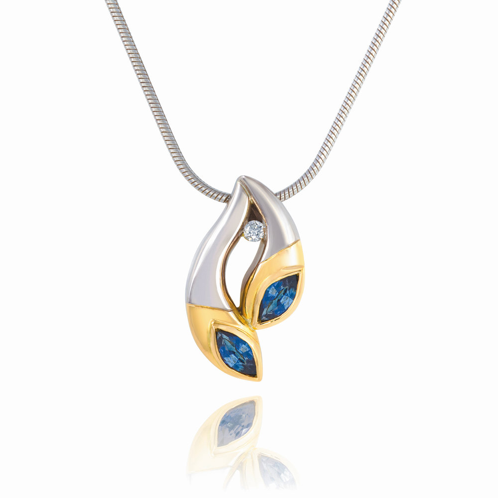 18ct white and yellow gold pendant set with two marquise sapphires and one round brilliant cut diamond. Complete on a 9ct white gold chain - £1,995
