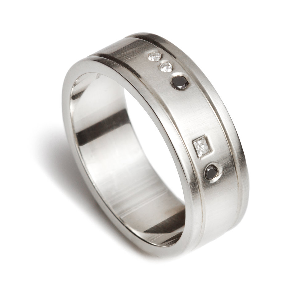 Silver, black diamond and white diamond ring - £270