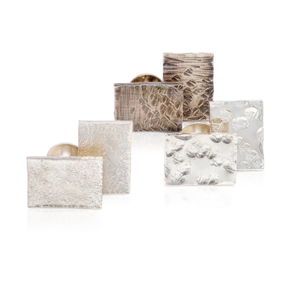 Silver cufflinks with various hamered textures and finishes - £178 per pair
