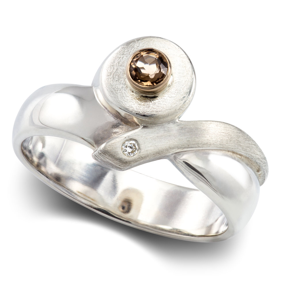 Silver dress ring set with one round smoky quartz in an 18ct white gold rubover setting and one round brilliant cut diamond invisibly set - £350