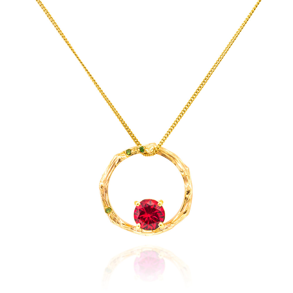 9ct yellow gold, lab-created ruby and treated green diamond pendant complete on a 9ct yellow gold chain- £755