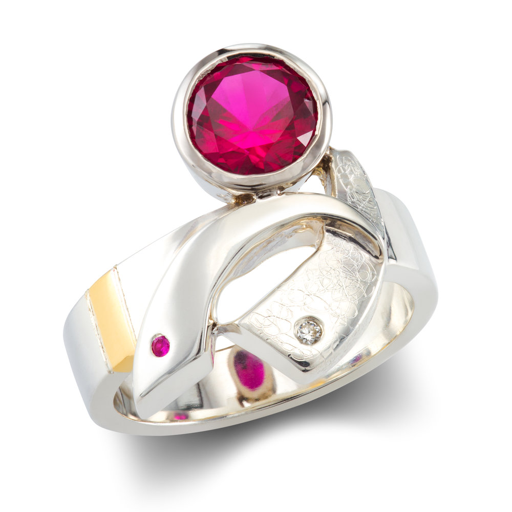 Silver and 9ct yellow gold dress ring (with a palladium rubover) set with two lab-created rubies and a round brilliant cut diamond - £610