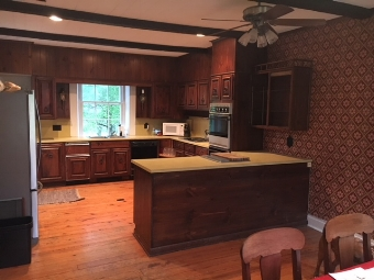 Kitchen as it appeared in 2015 before renovation.  Check out the wallpaper!