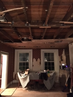 Exposed joists, and area where beam had to go in to support the house above.