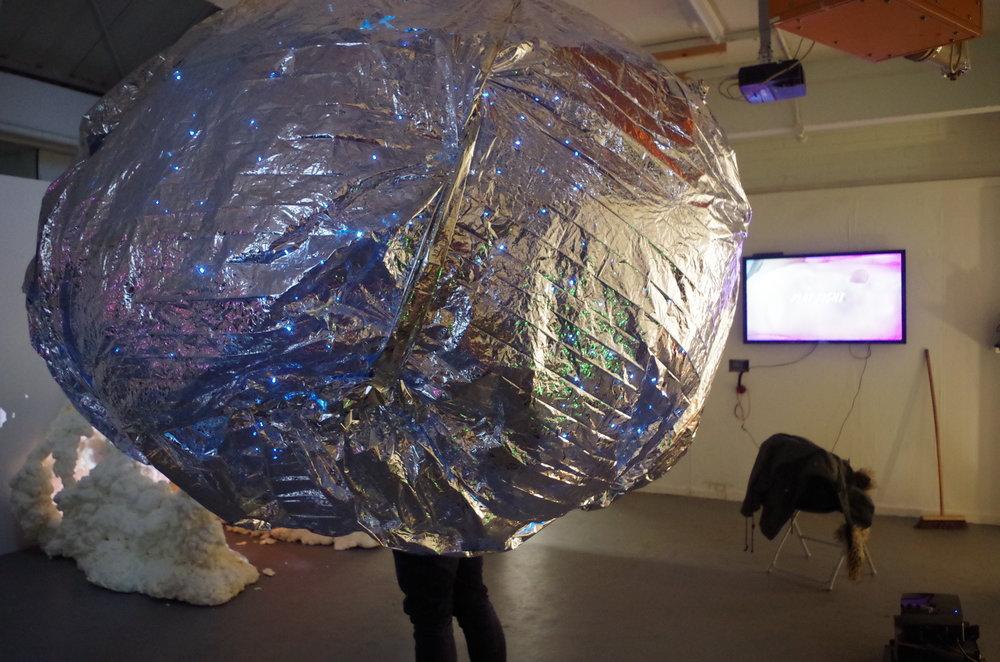 Egg , 2017, installation, emergency foil blankets, lighting, chicken wire, tubing,3000mm in diameter