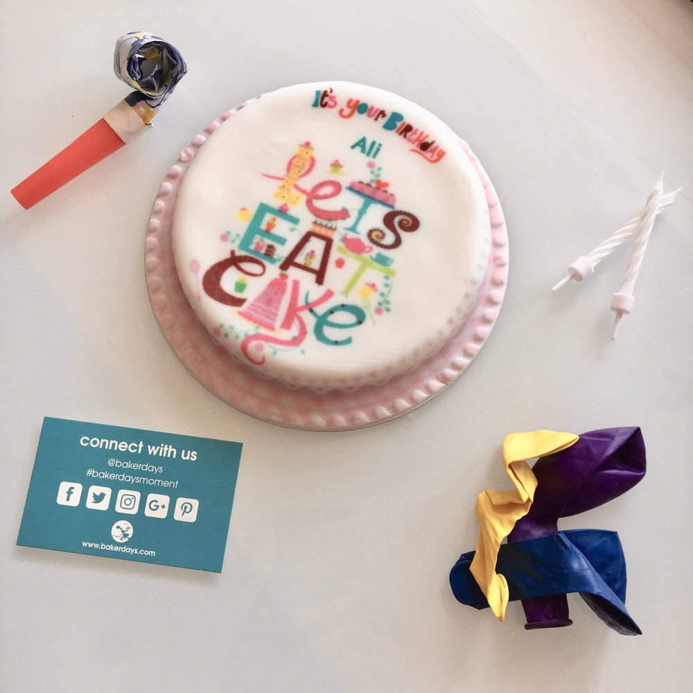 Bakerdays cake review - cake with candles, balloons, party blower