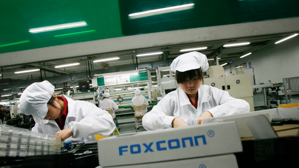 Foxconn employees building... iPhones. Maybe. Who knows.