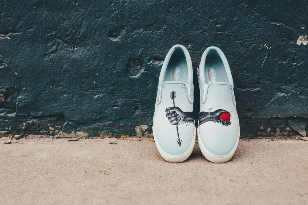 Bucket Feet - BucketFeet found Jose Rementeria's art through a contest held in conjunction with Russell Simmon's Rush Philanthropic Arts Foundation—the result is this canvas slip-on with powerful, bold art meant to remind people to keep the balance on relationships.