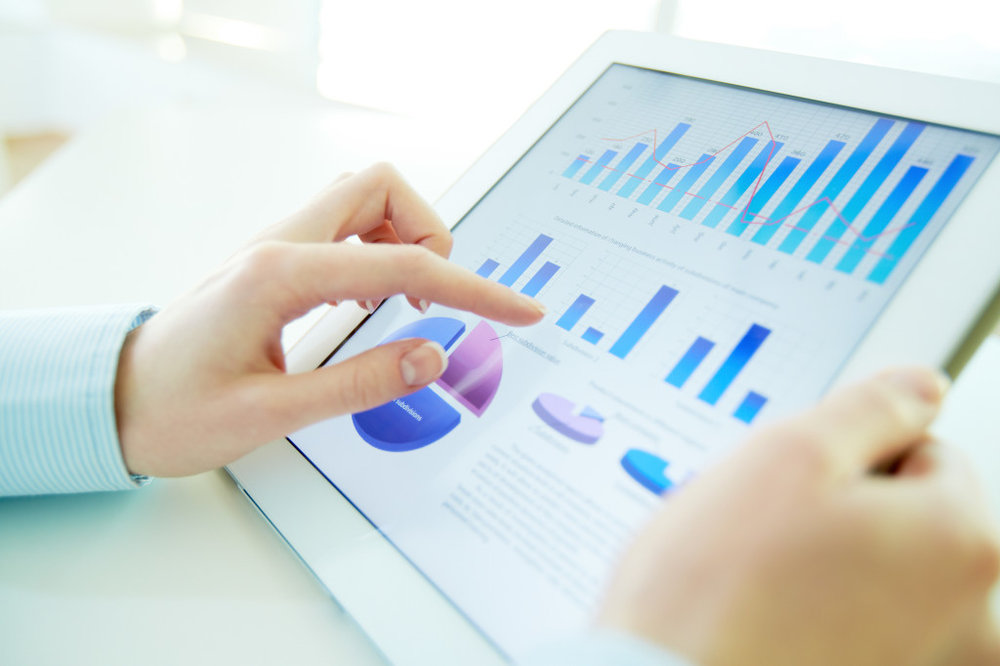 Woman-Analyzing-Metrics-on-Tablet-1024x682-1.jpg