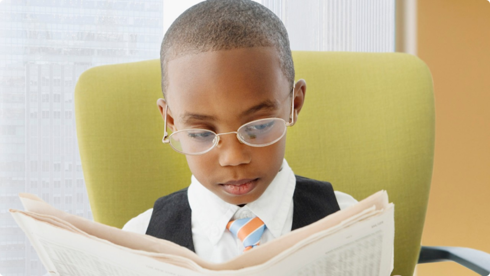 033114-b-real-finances-kids-money-spending-reading-newspaper.png
