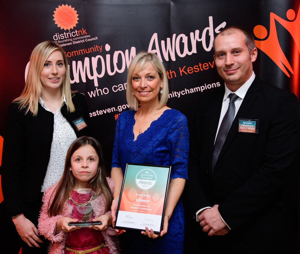 Kelly Langworthy & Tony Freitas presents the Contribution to Health & Wellbeing award to Amelia Bailey and her daughter Matilda.
