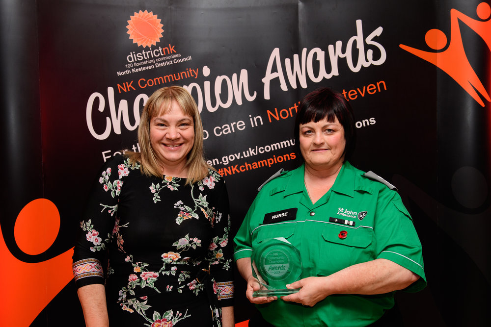 Karen James, Your Local Lincs Magazine presents the Longstanding Contribution award to Mandy Harsley.