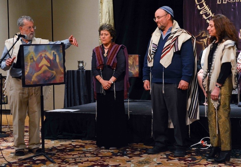 Rabbi Daniel Siegel ordains three new dayanim at the OHALAH 2017 conference. Left to right: Rabbi Daniel Siegel, Rabbi Sara Leya Schley (California, USA), Rabbi Simcha Daniel Burstyn (Kibbutz Lotan, Israel), and Rabbi Hannah Dresner (British Columbia, Canada).