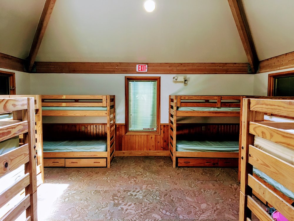 Each of our traditional cabins has six bunk beds.  During summer camp, two staff will be in each cabin.