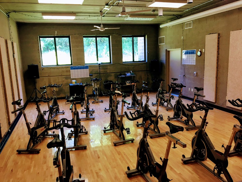 Spin studio with numerous group exercises classes scheduled.
