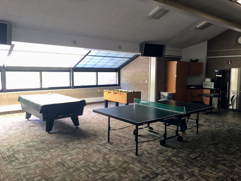 Game room with pool table, fooseball, and ping pong.  Available for birthday party rentals.