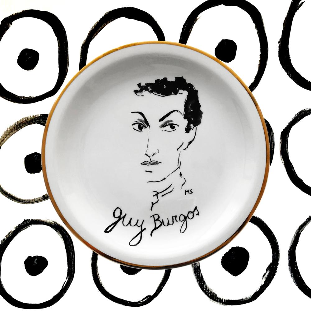"""Guy Burgos - Actor, modelo, dealer de arte y conocido bon vivant, Guy Burgos fue parte del jet set neoyorkino de los '70 y '80, colaborando con Andy Warhol en la revista """"Interview"""" y celebrando sus cumpleaños en Studio 54. Su matrimonio con lady Sarah Churchill lo unió por un tiempo con la aristocracia europea."""