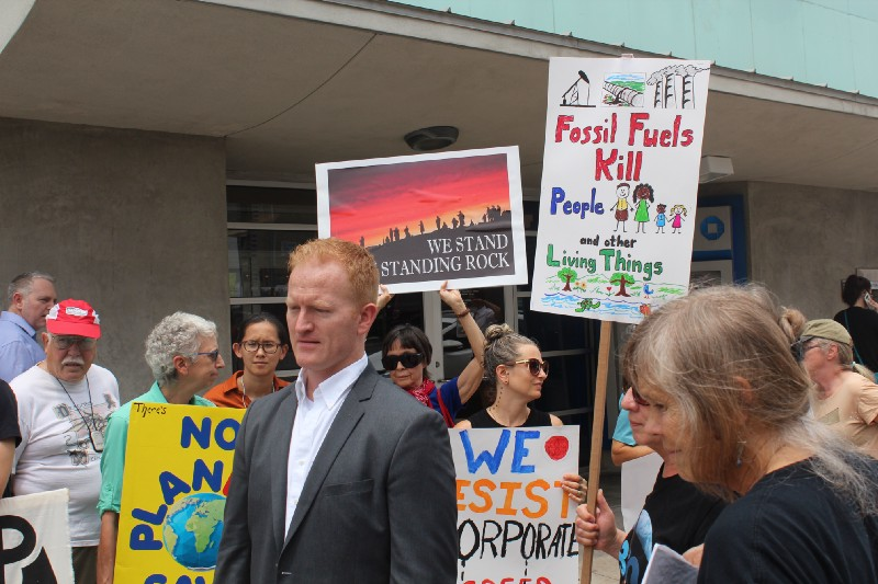 Congressional candidate Derrick Crowe (TX-21) helps lead a fossil fuel divestment protest on 11 May 2017. Photo credit: Matthew Krausse