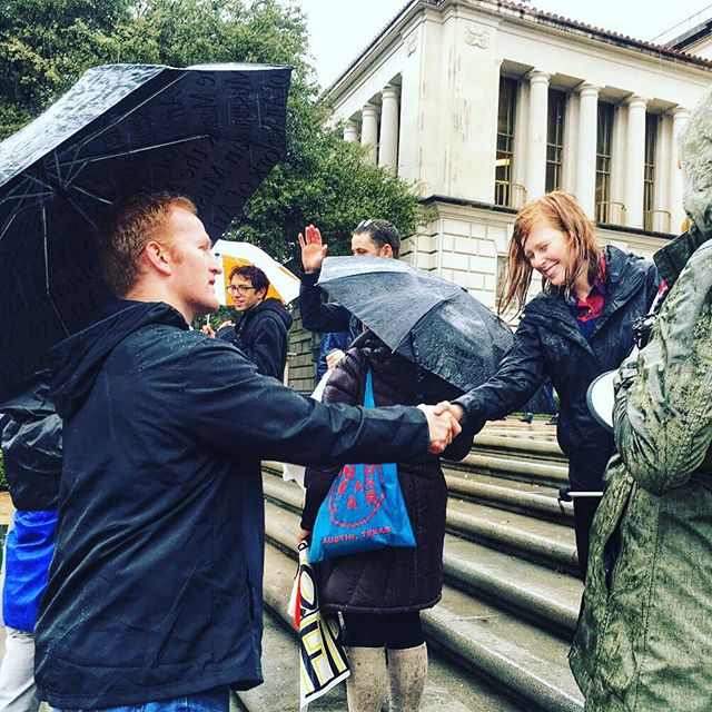 """Today, I joined UT grad students in the rain to say """"no"""" to the #goptaxscam and their attack on education. #tx21 #electcrowe #croweforcongress"""