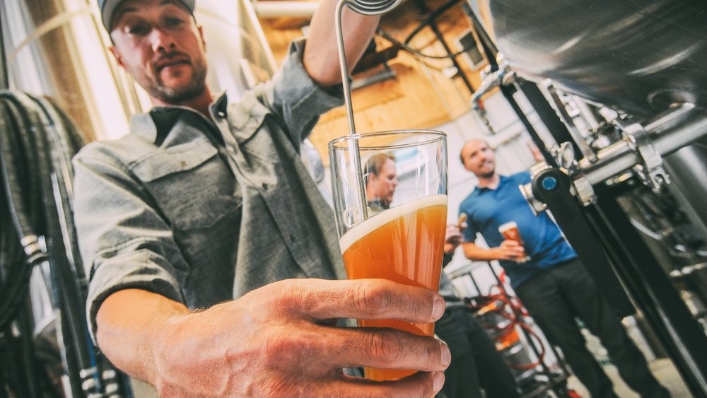 Filling a glass with COBREWed beer