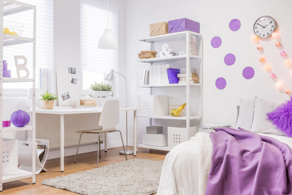 Maximize every inch of space in your small dorm room with shelving.