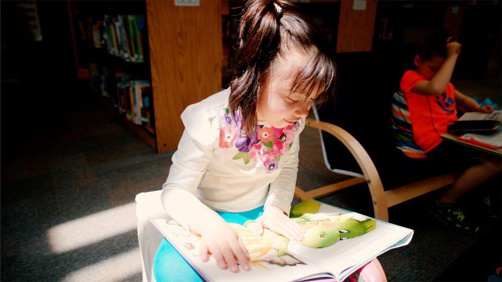 Library Girl Reading.jpg