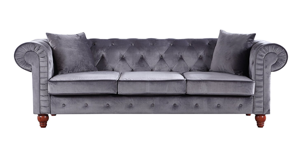 Classic velvet button style sofa.png