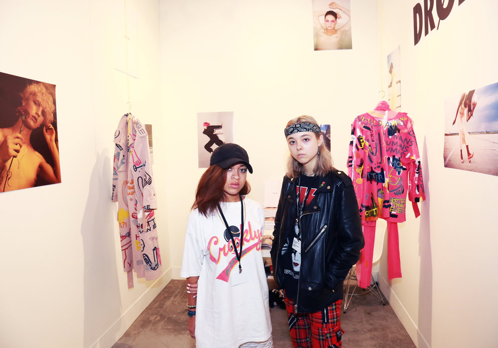 DRØME Editor in Chief Caroline Gorman and Executive Director Satchel Lee in their booth at NADA Art Fair - coats by OR