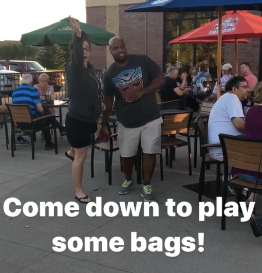 Shannon playing bags.png