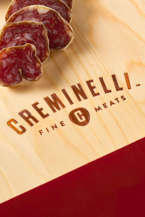 Close-up of Creminelli Fine Meats branded cutting board.
