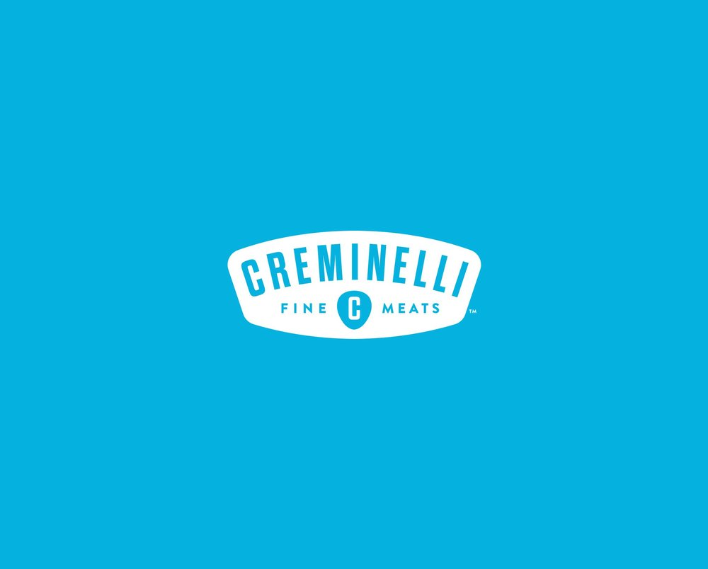 Creminelli Fine Meats logo on blue background