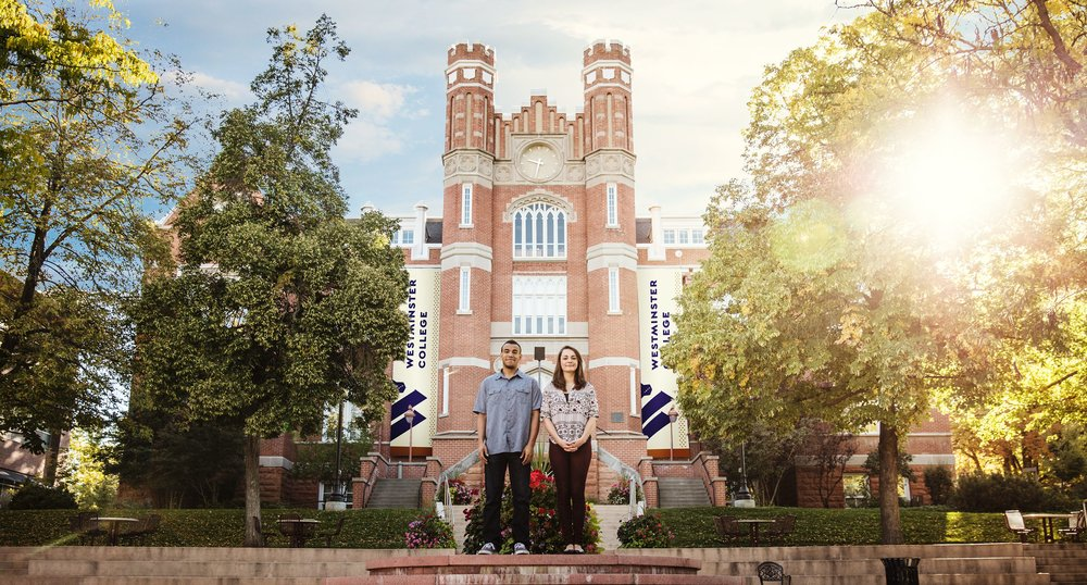 Promotional Photo of students and new identity in front of the college.
