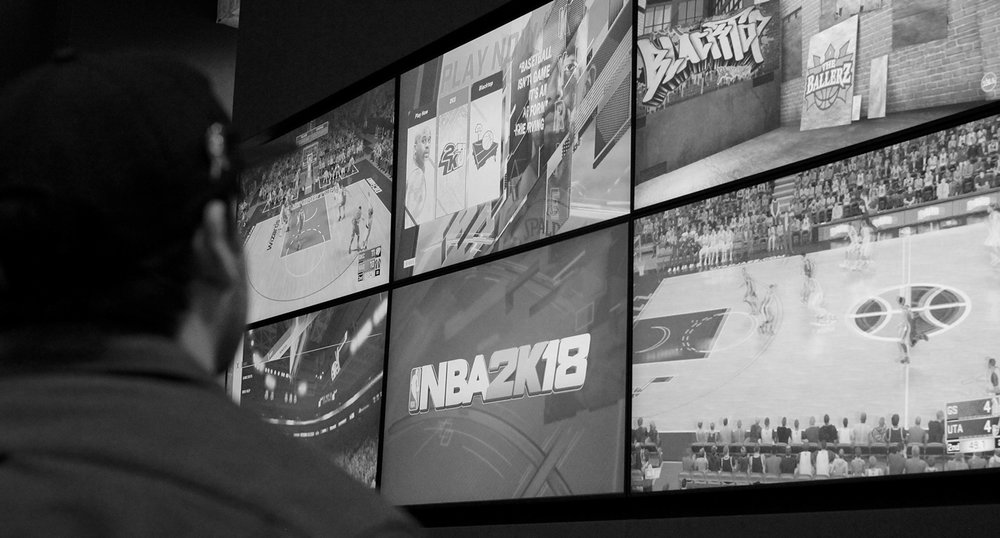 Black and White close up of games on media wall