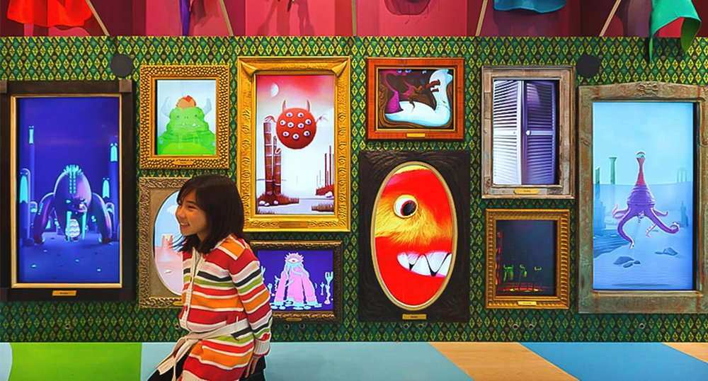 Girl and Interactive Monster Wall