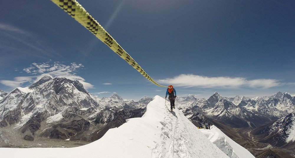 Roped Climber on Mountain Peak
