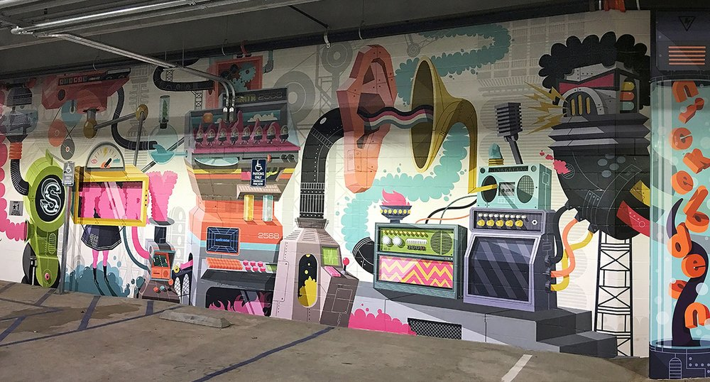 Painted Wall in front of Facility Parking Garage with Radio