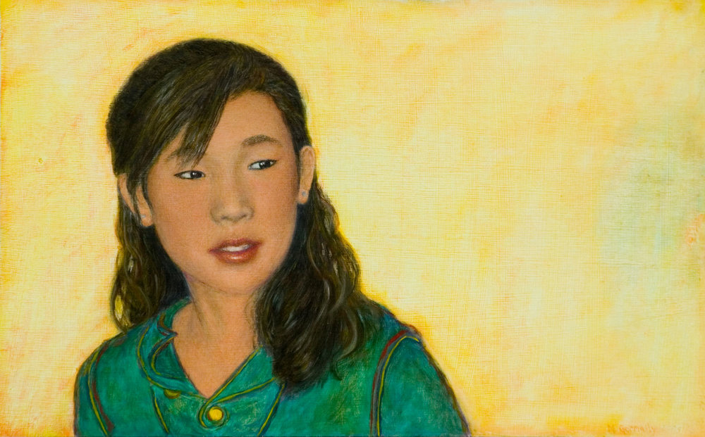 Portrait of a young woman in green
