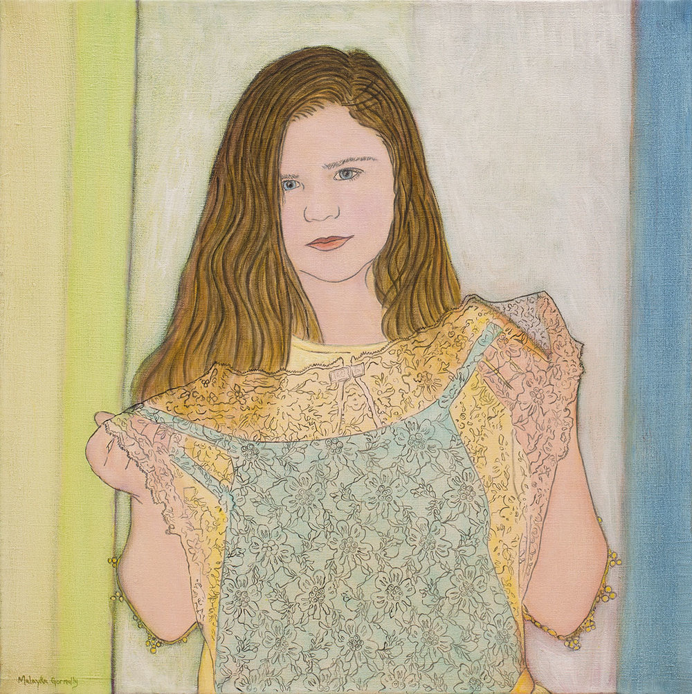 Portrait of a girl holding up a lace dress