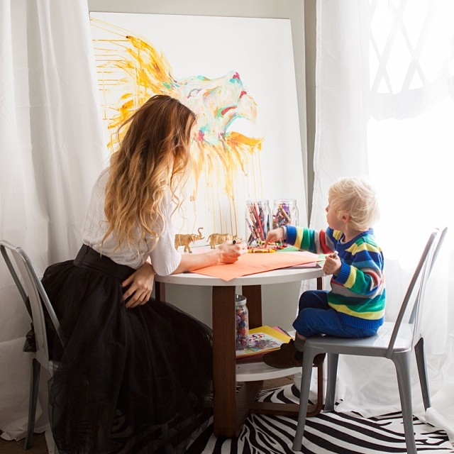 Caught crafting at the kids table // #belandbeau black tulle coming to the shop soon, @ladynoel lion painting, @thelandofnod play table and chair, @rugsusa zebra hide rug